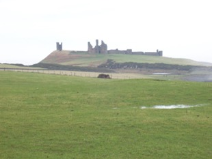 Walking the Northumberland Coast & Castle Path. Isolated Dunstanburgh Castle