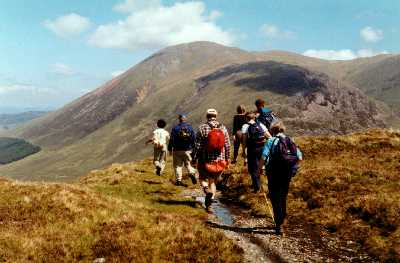 walking in scotland. 7 night whiskey trail Aviemore to Cullen scotland. in the Scottish highlands on the Speyside way through the cairngorm mountains in scotland heading for a wee dram of whisky.